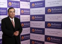 Mukesh Ambani, chairman of Reliance Industries Limited, poses for photographers before addressing the annual shareholders meeting in Mumbai, India, June 12, 2015. India's Reliance Industries Ltd will start commercial 4G telecommunication services by December, Chairman Mukesh Ambani said on Friday. REUTERS/Shailesh Andrade