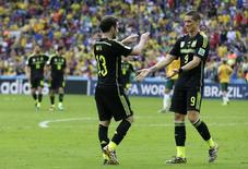Spain's Juan Mata celebrates with Fernando Torres (9) after scoring a goal during the 2014 World Cup Group B soccer match between Australia and Spain at the Baixada arena in Curitiba June 23, 2014. REUTERS/Henry Romero