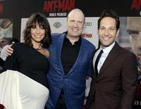 "Cast members Evangeline Lilly (L) and Paul Rudd (R) pose with producer Kevin Feige at the premiere of Marvel's ""Ant-Man"" in Hollywood, California June 29, 2015. REUTERS/Kevork Djansezian"