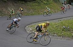 From R-L, Team Sky rider Chris Froome of Britain, the race overall leader's yellow jersey, speeds downhill followed by Movistar rider Nairo Quintana of Colombia and Tinkoff-Saxo rider Alberto Contador of Spain in the Glandon pass during  the 138-km (85.74 miles) 19th stage of the 102nd Tour de France cycling race from Saint-Jean-de-Maurienne to La Toussuire-Les Sybelles in the French Alps mountains, France, July 24, 2015. REUTERS/Eric Gaillard