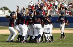 United States players celebrate on the field after defeating Canada in the women's baseball gold medal match during the 2015 Pan Am Games at Ajax Pan Am Ballpark. Mandatory Credit: Rob Schumacher-USA TODAY Sports