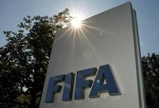 The logo of FIFA is seen in front of its headquarters in Zurich, Switzerland July 20, 2015. REUTERS/Arnd Wiegmann