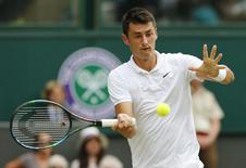 Bernard Tomic of Australia hits a shot during his match against Novak Djokovic of Serbia at the Wimbledon Tennis Championships in London, July 3, 2015.            REUTERS/Suzanne Plunkett