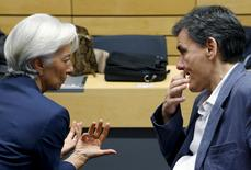 International Monetary Fund (IMF) Managing Director Christine Lagarde talks to Greek Finance Minister Euclid Tsakalotos (R) during a euro zone finance ministers meeting in Brussels, Belgium, July 12, 2015. REUTERS/Francois Lenoir