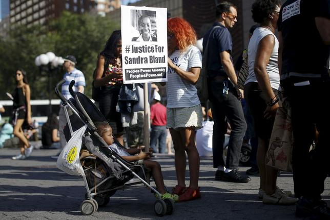 A child holds a sign about Sandra Bland, who died in police custody, during a rally against police violence in New York July 22, 2015. Photo: Reuters/Shannon Stapleton