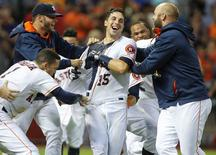 Jul 30, 2015; Houston, TX, USA; Houston Astros catcher Jason Castro (15) celebrates with teammates after hitting a three-run walk off home run in the ninth inning against the Los Angeles Angels at Minute Maid Park. The Astros won 3-0. Mandatory Credit: Troy Taormina-USA TODAY Sports