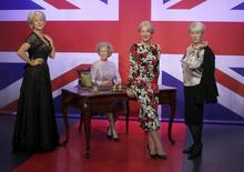 Helen Mirren (2nd R) poses with waxwork models of herself at Madame Tussauds in London, July 30, 2015. REUTERS/Peter Nicholls