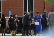 Mourners arrive for the funeral of Kristina Bobbi Brown, the only child of singer Whitney Houston at Saint James United Methodist Church in Alpharetta, Georgia, August 1, 2015. REUTERS/Tami Chappell