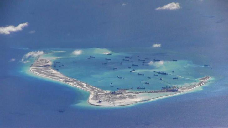 Chinese dredging vessels are purportedly seen in the waters around Mischief Reef in the disputed Spratly Islands in this still image from video taken by a P-8A Poseidon surveillance aircraft provided by the United States Navy May 21, 2015. REUTERS/U.S. Navy/Handout via Reuters