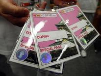 A volunteer with IAAF's local organizing committee displays the credential given to athletes who are selected for drug testing in the anti-doping offices at the 11th IAAF World Athletics Championships in Osaka August 24, 2007.  The competition begins August 25.   REUTERS/Brian Snyder (JAPAN