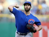 Aug 4, 2015; Pittsburgh, PA, USA; Chicago Cubs starting pitcher Jake Arrieta (49) delivers a pitch against the Pittsburgh Pirates during the first inning at PNC Park. Mandatory Credit: Charles LeClaire-USA TODAY Sports