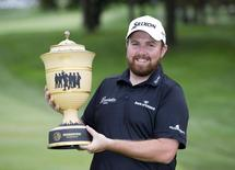 Shane Lowry holds the Gary Player Cup after winning the Bridgestone Invitational at Firestone Country Club - South Course. Mandatory Credit: Greg Bartram-USA TODAY Sports