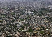 Здания в Дели 18 августа 2009 года. Подземные толчки сотрясли здания в центре многомиллионной столицы Индии, сообщил очевидец. REUTERS/Fayaz Kabli