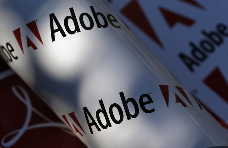Adobe company logos are seen in this picture illustration taken in Vienna in this July 9, 2013 file photo.  REUTERS/Leonhard Foeger