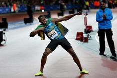 Athletics - IAAF Diamond League 2015 - Sainsbury's Anniversary Games - Queen Elizabeth Olympic Park, London, England - 24/7/15 Jamaica's Usain Bolt celebrates after winning the Men's 100m Final Action Images via Reuters / Matthew Childs