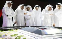 Secretary-General Hassan Al-Thawadi (C) of Qatar's Supreme Committee for Delivery and Legacy, the nation's 2022 World Cup organising committee, speaks during a news conference to announce the start of work on the Al-Khor Stadium in Al-Khor June 21, 2014. REUTERS/Mohammed Dabbous