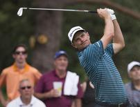 Aug 8, 2015; Akron, OH, USA; Justin Rose hits a tee shot during the third round at Firestone Country Club - South Course. Mandatory Credit: Greg Bartram-USA TODAY Sports