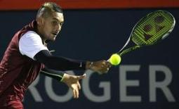 Aug 12, 2015; Montreal, Quebec, Canada;  Nick Kyrgios of Australia hits a shot against Stan Wawrinka of Switzerland (not pictured) during the Rogers Cup tennis tournament at Uniprix Stadium. Jean-Yves Ahern-USA TODAY Sports