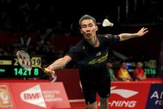 Malaysia's Lee Chong Wei hits a return to Germany's Marc Zwiebler during their men's singles badminton match at the BWF World Championship in Jakarta, August 12, 2015. REUTERS/Nyimas Laula