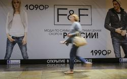 """An advertising banner, which announces the opening of an F&F clothing store in June 2015, is on display behind the window of a closed outlet at a retail and entertainment centre in Moscow, Russia, August 14, 2015. British retailer Tesco Plc has suspended opening its F&F clothing stores in Russia, retail industry sources told Reuters. Debruss, the Russian franchise operator for British department store group Debenhams, said in March it planned to open two F&F outlets in June and one more in August 2015 in Moscow shopping malls. None of the stores has opened, and Debruss said on Friday it was """"not currently working with F&F"""". It declined further comment. REUTERS/Maxim Shemetov - RTX1OA38"""