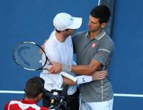 Aug 15, 2015; Montreal, Quebec, Canada; Andy Murray of Great Britain (L) and Novak Djokovic of Serbia (R) congratulate each other during the Rogers Cup tennis tournament at Uniprix Stadium.  Jean-Yves Ahern-USA TODAY Sports