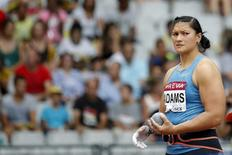 Valerie Adams of New Zealand competes in the women's shot put event during the IAAF Diamond League athletics meeting at the Stade de France Stadium in Saint-Denis, near Paris, France, July 4, 2015.  REUTERS/Stephane Mahe