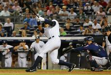 Aug 18, 2015; Bronx, NY, USA;  New York Yankees designated hitter Alex Rodriguez (13) hits a Grand Slam home run during the seventh inning against the Minnesota Twins at Yankee Stadium. Mandatory Credit: Anthony Gruppuso-USA TODAY Sports