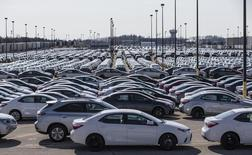 New cars are seen at the Toyota plant in Cambridge, in this March 31, 2014 file photo.  REUTERS/Mark Blinch