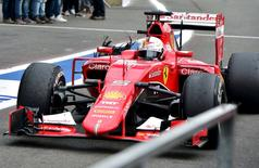 Ferrari Formula One driver Sebastian Vettel of Germany drives in the pit lane after a tyre failure during the Belgian F1 Grand Prix in Spa-Francorchamps, Belgium, August 23, 2015. REUTERS/Andrej Isakovic/Pool