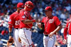 Aug 23, 2015; Washington, DC, USA; Washington Nationals starting pitcher Jordan Zimmermann (27) talks with Nationals catcher Wilson Ramos (40) against the Milwaukee Brewers in the fourth inning at Nationals Park. Mandatory Credit: Geoff Burke-USA TODAY Sports