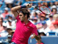 Aug 23, 2015; Cincinnati, OH, USA; Roger Federer (SUI) returns a shot against Novak Djokovic (not pictured) in the finals during the Western and Southern Open tennis tournament at the Linder Family Tennis Center. Aaron Doster-USA TODAY Sports