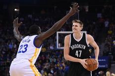 November 13, 2014; Oakland, CA, USA; Brooklyn Nets forward Andrei Kirilenko (47) controls the basketball against Golden State Warriors forward Draymond Green (23) during the first quarter at Oracle Arena. Mandatory Credit: Kyle Terada-USA TODAY Sports