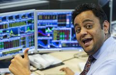 Pranab Patel, a trader at Belgian KBC bank, reacts on the trading floor at the bank headquarters in Brussels, Belgium August 25, 2015. REUTERS/Yves Herman