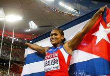 First placed Denia Caballero of Cuba celebrates her victory in the women's discus throw final during the 15th IAAF World Championships at the National Stadium in Beijing, China, August 25, 2015.     REUTERS/Kai Pfaffenbach