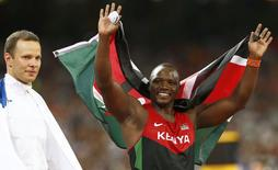 Julius Yego of Kenya celebrates after winning gold next to third placed Tero Pitkamaki of Finland (L) in the men's javelin throw final during the 15th IAAF World Championships at the National Stadium in Beijing, China August 26, 2015.    REUTERS/David Gray