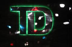 A logo of Toronto Dominion Bank (TD) is seen at a branch location in Toronto, March 6, 2014. REUTERS/Aaron Harris