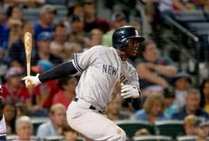 Aug 28, 2015; Atlanta, GA, USA; New York Yankees shortstop Didi Gregorius (18) hits an RBI single in the eighth inning of their game against the Atlanta Braves at Turner Field. Jason Getz-USA TODAY Sports