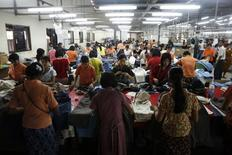 Workers tailor and arrange clothing at a garment factory at Hlaing Tar Yar industry zone in Yangon March 10, 2010. REUTERS/Soe Zeya Tun