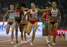 Eunice Sum of Kenya, Marina Arzamasova of Belarus and Melissa Bishop (L-R) of Canada cross the finish line in the women's 800m event during the 15th IAAF World Championships at the National Stadium in Beijing, China August 29, 2015.     REUTERS/Lucy Nicholson
