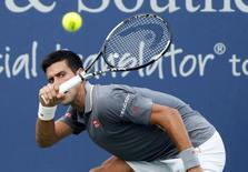 Cincinnati, OH, USA; Novak Djokovic (SRB) returns a shot against Benoit Paire (not pictured) on day five during the Western and Southern Open tennis tournament at Linder Family Tennis Center on Aug 19, 2015.  Aaron Doster-USA TODAY Sports