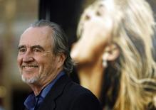 "Director Wes Craven attends the premiere of the movie ""Drag Me to Hell"" at the Grauman's Chinese theatre in Hollywood, California in this May 12, 2009 file photo. REUTERS/Mario Anzuoni"