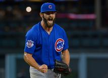 Aug 30, 2015; Los Angeles, CA, USA; Chicago Cubs starting pitcher Jake Arrieta (49) reacts after thawing his final pitch of the ninth inning for a no hitter against the Los Angeles Dodgers at Dodger Stadium. Mandatory Credit: Jayne Kamin-Oncea-USA TODAY Sports