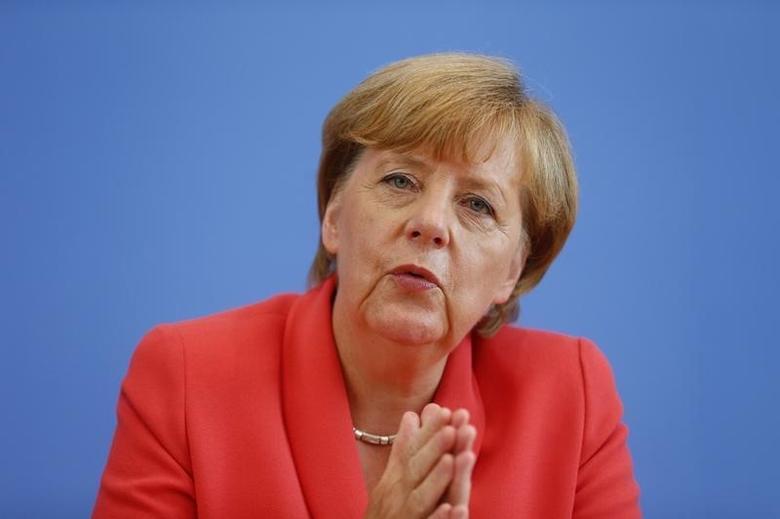 German Chancellor Angela Merkel addresses an annual news conference in Berlin, Germany, August 31, 2015. REUTERS/Hannibal Hanschke