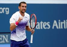 Sep 2, 2015; New York, NY, USA; Marin Cilic of Croatia celebrates after recording match point against Evgeny Donskoy of Russia on day three of the 2015 U.S. Open tennis tournament at USTA Billie Jean King National Tennis Center. Mandatory Credit: Geoff Burke-USA TODAY Sports