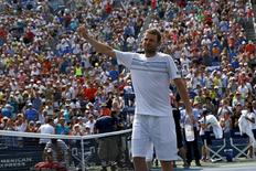 Mardy Fish of the U.S. waves to the crowd as he leaves the court after losing to Feliciano Lopez of Spain in five sets at the U.S. Open Championships tennis tournament in New York, September 2, 2015. The match was the last of Fish's professional career. REUTERS/Mike Segar