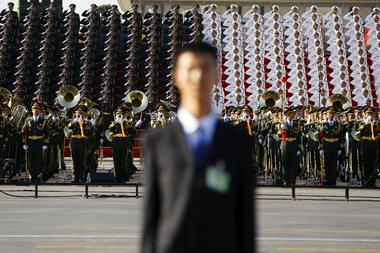 Military band plays at the Tiananmen Square before a military parade to...
