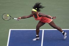 Serena Williams of the U.S. hits a return to Kiki Bertens of the Netherlands during their second round match at the U.S. Open Championships tennis tournament in New York, September 2, 2015.       REUTERS/Adrees Latif