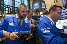 Traders work on the floor of the New York Stock Exchange shortly after the markets opened in New York September 3, 2015.  REUTERS/Lucas Jackson