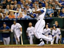 Sep 3, 2015; Kansas City, MO, USA; Kansas City Royals center fielder Lorenzo Cain (6) hits a three-run home run against the Detroit Tigers during the second inning at Kauffman Stadium. Mandatory Credit: Peter G. Aiken-USA TODAY Sports