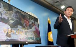 A politician demonstrates a karaoke machine in which a song and footage from North Korea has been installed, in Seoul, South Korea, September 3, 2015. REUTERS/Do Kwang-hwan/Yonhap